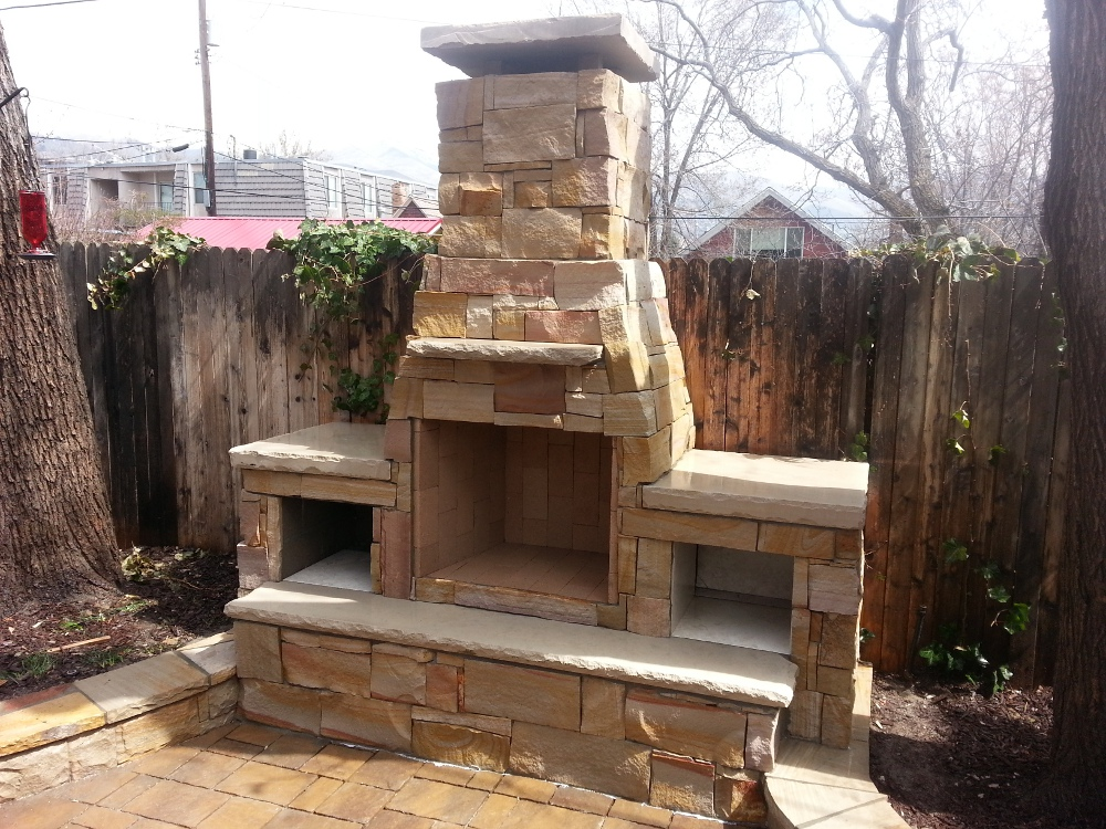 Outdoor fireplace with dual wood boxes for Where to buy outdoor fireplace