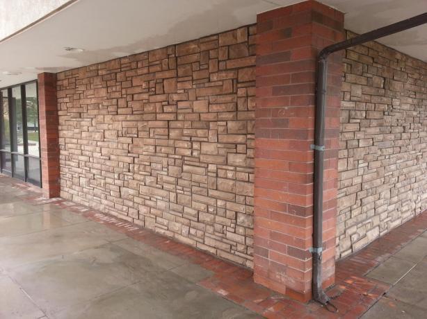 Cultured stone over stucco for Stucco facade